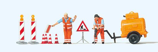 Straßenbauarbeiter mit Kompressor