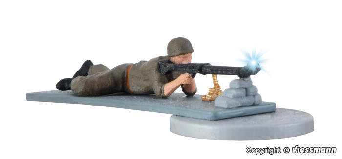 Soldat, liegend mit Gewehr u. Muendungsfeuer
